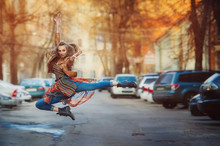 Dancer Woman Jumping On The St...