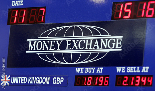 The Currency Exchange Rate For British Pound Is Seen At A Money Site In New York