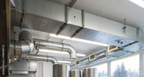 Fotomural Ventilation pipe system in kitchen interior.