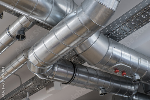 Fotografía Ventilation pipe system in kitchen interior.