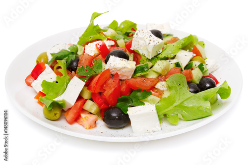 Fotografie, Obraz  Greek Salad (Feta Cheese, Olive and Vegetables) isolated on white background
