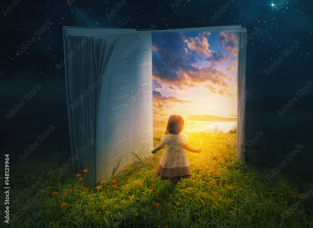 Fototapety, obrazy: Little girl and open book