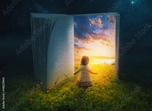 Spoed Foto op Canvas Zwart Little girl and open book