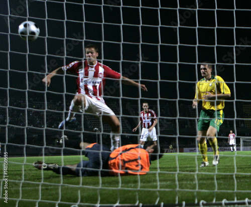 AaB Aalborg s Risgard scores past FBK Kaunas s goalkeeper Kello during  their Champions League soccer match in Kaunas 028e778696