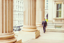 Middle Age American Businessman Walking To Work Inside Vintage Office Building In New York