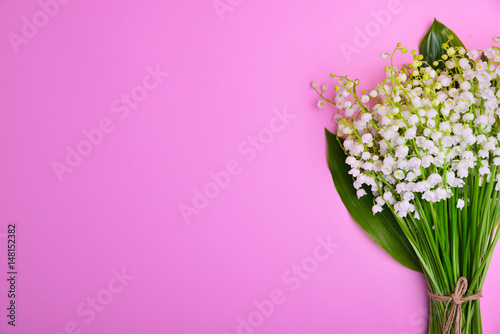 Wall Murals Lily of the valley Bouquet of white lilies of the valley on a pink surface