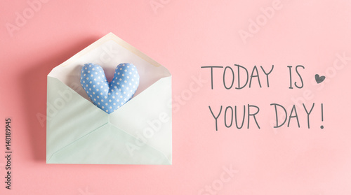Photo  Today Is Your Day message with a blue heart cushion