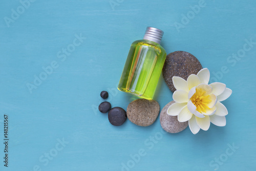 Spa Concept Background Oil Bottle With White Flower And Round Stone