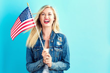 Young Woman Holding American F...