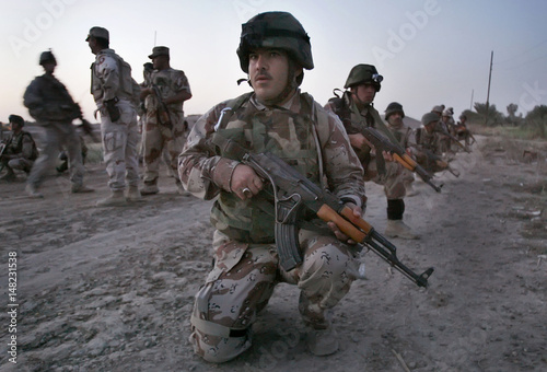Iraqi soldiers prepare to take part in a joint operation