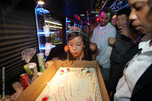 Christine Tran Blows Out The Candles On Her Cake While Celebrating Birthday A Party