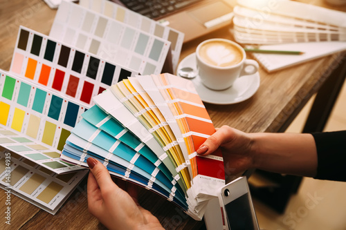 Hands of female designer in office working with colour samples Fototapeta