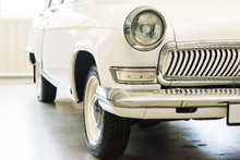 Classic Car With Closeup On Headlights. Vintage Vehicle Front Detail