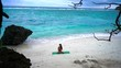 Girl on the beach practicing yoga