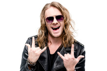 Portrait Of Handsome Rocker In Black Leather Jacket And Sunglasses Showing Rock Signs Isolated On White, Rock Star Concept