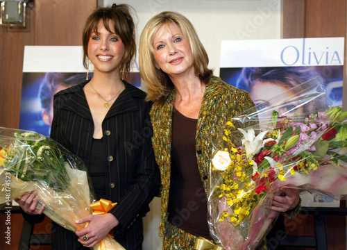 Australian pop star Olivia Newton-John (R), with her 17-year