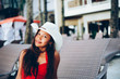 Beautiful young woman sitting on sunbed with the hat on the beach resort, summer vacation