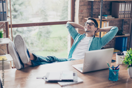 Canvas Prints Relaxation Happy calm smiling man having a rest after solving all the tasks at work
