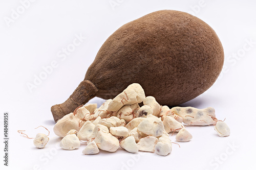 Poster Baobab Baobab fruit (Adansonia digitata) on white background, pulp and powder, superfood
