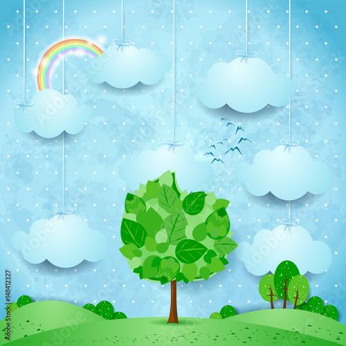 surrealistyczny-krajobraz-z-chmurami-i-duzym-drzewem