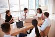 Leinwandbild Motiv Group Of Medical Staff Meeting Around Table In Hospital