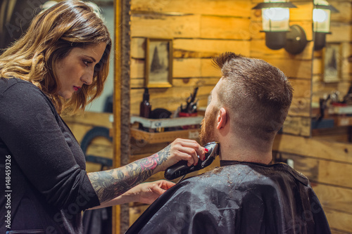 Woman haircutting a man Poster