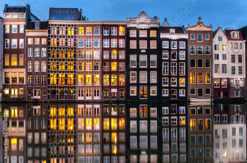 Fotografía  Traditional Buildings along a Canal in Amsterdam at Twilight.