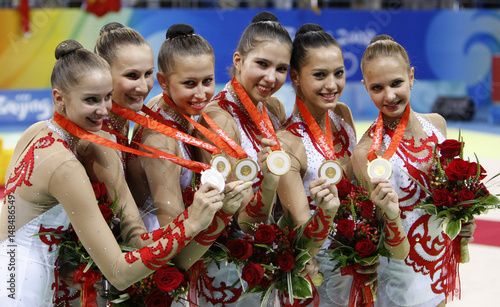Russia's gold medallist team hold their medals after the group all