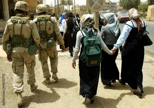 U S  soldiers escort Iraqi schoolgirls home through Baghdad