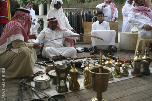A vendor holds a sword at al-Zall souk in downtown Riyadh - Buy this