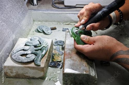 Valokuva  Hands of a Jade ornamental green rock carver at work