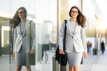 Businesswoman In Stylish Suit ...