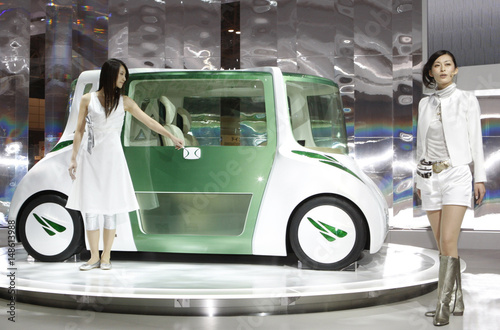 Models Pose With Toyota Motor Corps Rin Concept Vehicle During The