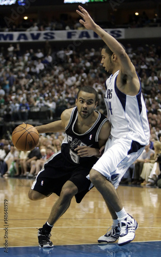 Spurs Parker drives against Mavericks Harris in first half of Game 3