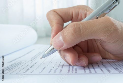 Fotografie, Obraz  Hand with pen over application form, Filling name in personal details