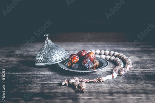 Fotografia Date-palm is placed on silver