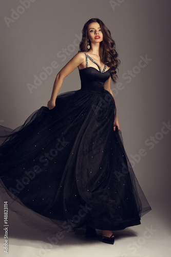 Young Beautiful Woman Standing And Posing In Black Ball Gown On