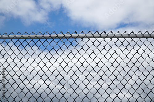 Fotografie, Obraz  iron chain link fence against sky