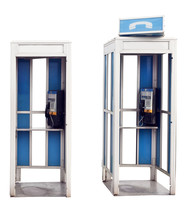 Two Isolated Vintage Outdoor Phone Booths.