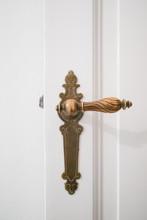 Beautiful Old Door Handle On White Door