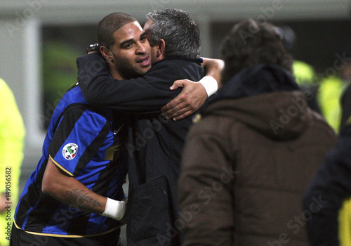Inter milans adriano is congratulated by coach mourinho after inter milans adriano is congratulated by coach mourinho after scoring against ac milan during italian serie m4hsunfo