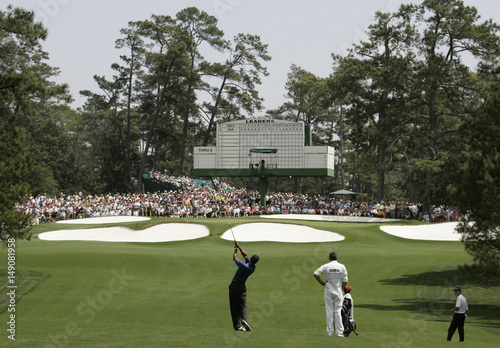 Tiger Woods of the U.S. hits to the seventh green during practice ...