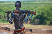 Kara Tribe Man With Rifle Look...