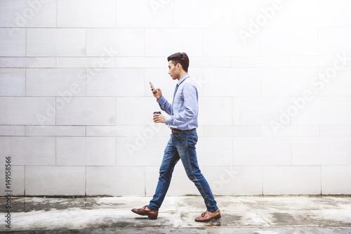 Fotografie, Obraz  Businessman use smart phone while walk outdoor