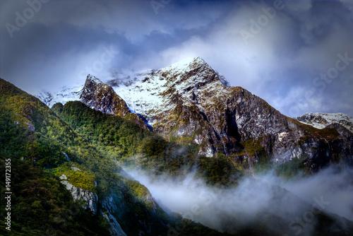 Fotografie, Tablou  Snow Capped Peak in the Clouds