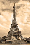 Fototapeta Fototapety z wieżą Eiffla - While French elections are making headlines, Eiffel Tower remains popular as ever with tourists, Paris France. Sepia filter