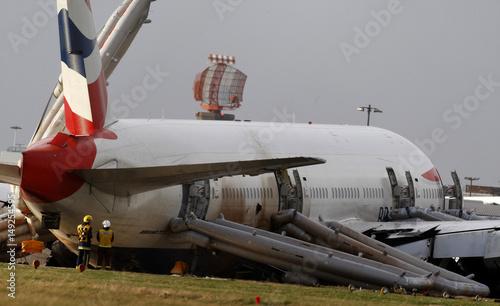 Emergency service personnel attend to British Airways plane