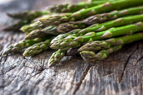 Fresh organic asparagus on rustic background Canvas Print