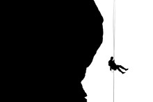 Silhouette Of Rock Climber Belaying Hoodoo