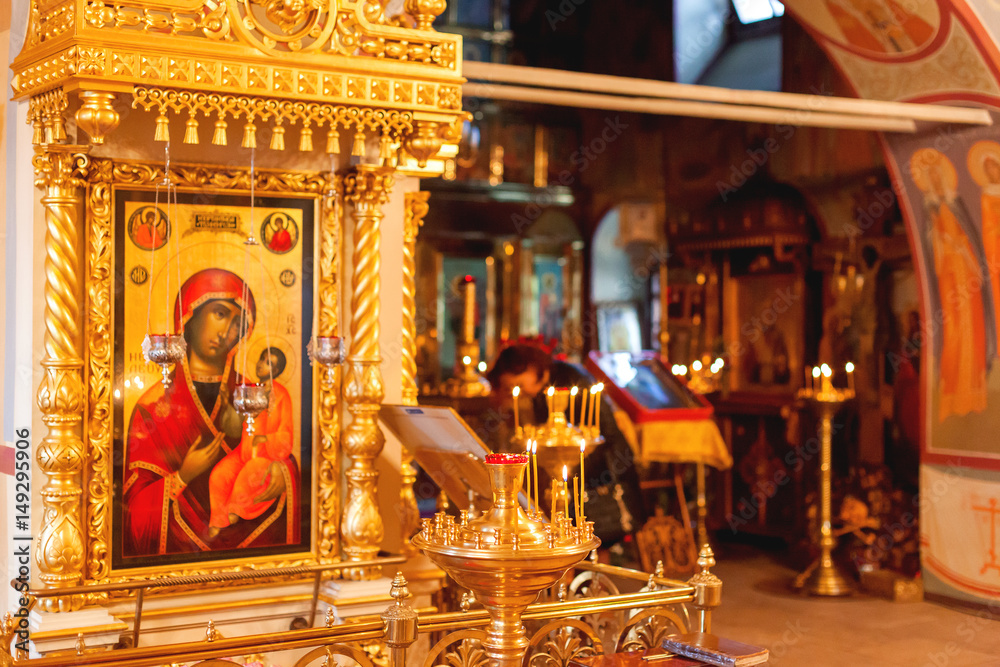 Fototapety, obrazy: Golden candleholder and icons, traditional interior of Orthodox church. Russia.